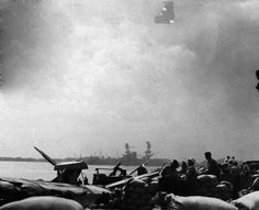 80-G-32476: Japanese Attack on Pearl Harbor, December 7, 1941. Gun crews during the attack. The sailors were on the alert at the their battle stations at Naval Air Station. (9/15/15).