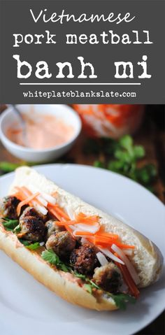 Vietnamese pork meatball banh mi with pickled carrot and daikon, fresh cilantro and spicy sriracha mayonnaise.