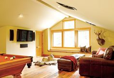"""This space, above the garage, was designed as a """"guys"""" getaway. Man's best friend is always welcome, too."""