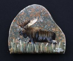 Hand Painted Bull Moose. Height 5, Width 5 1/2, Thickness at base 1. Selected from the shores of Lake Superior, cut and hand-painted to