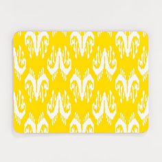 Yellow and White Ikat Cork Placemats, Set of 2 | Sturdy enough to keep from sliding around on table, and clean with ease.