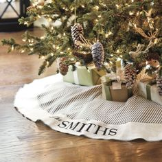 Monogrammed Ticking Stripe Tree Skirt  Two of our favorite fabrics, classic ticking and cream burlap, come together for a timeless holiday look. Burlap border is serged in black and block printed by hand with your family name. Hand sewn of unlined 100% cotton ticking with black tape ribbon closures.