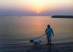 Walking the dog on Budaiya beach at sunset