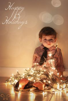 Kid tangled in the christmas lights - Christmas Card Family Photo Ideas