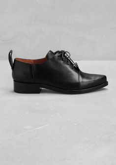 A pair of pointed lace-up flats featuring raw edges and a chic tomboy style.