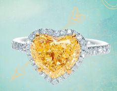 Tiffany yellow heart cut diamond ring surrounded by white diamonds.