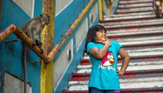 A small girl taking a picture with a cute monkey at Batu Caves in Kuala Lumpur, Malaysia  More photos at http://www.asiatiq.com/super-cute-monkeys-batu-caves-kuala-lumpur/