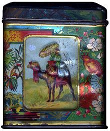 """vintage JG Eisler tea tin with scene of man riding camel and chinoiserie flowers and leaves [side of """"JG Eisler, Tee Importeur, Wien [Tea Importer, Vienna] tin, c. 1900, Austria"""