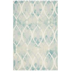 Anchor a bohemian seating group or add a splash of color to a contemporary ensemble with this hand-tufted wool rug, featuring a dip-dyed design in green and ...