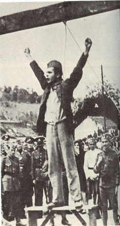 """Stjepan Filipović, a Croatian Partisan who fought against Axis forces during WWII, moments before his own execution.    Moments before dying, he threw his arms into the air and yelled, """"Death to fascism, freedom to the people!""""    Valjevo, Yugoslavia - May 22, 1942."""