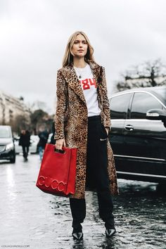This fall and winter, animal print coats are back and better than ever. As Pernille Teisbaek demonstrates, they are great for elevating a white tee and jeans or pants combo.