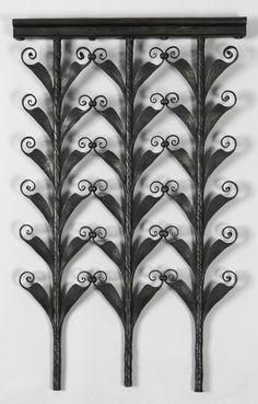 made by Samuel Yellin. It is dated 1940. This study or design of black wrought iron is composed of three vertical stylized branches with small curls growing out of V-shaped leaves that line the branches, connected at the curls.