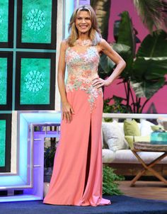 RACHEL ALLAN: Gown w/bodice in salmon, lime green & cream re-embroidered floral motifs enhanced in silver rhinestones on nude illusion, scoop neckline, sleeveless, skirt in solid salmon jersey  | Vanna White's dresses | Wheel of Fortune