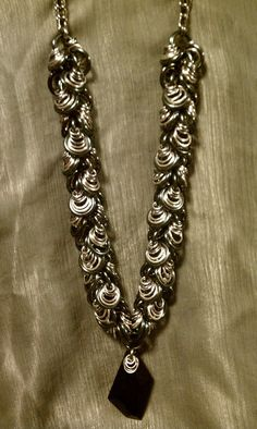 Super Shaggy Loops!! This is a statement necklace - focal bead is a large Jet Swarovski crystal. The necklace is a graduated Shaggy Loops weave.