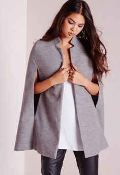 Get the layered look this season in this seriously chic grey cape jacket. This wool cape is so on point right now and our current obsession. Style over an all black look for a seriously on fleek style fix this season. Approx length 9...