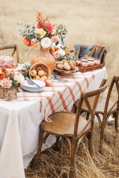 a chic and bright Thanksgiving table with bright florals, white pumpkins in cloches and a plaid tablecloth Thanksgiving Table, Thanksgiving Decorations, Seasonal Decor, Harvest Party Decorations, Fall Home Decor, Autumn Home, Autumn Fall, Deco Champetre, Fall Picnic