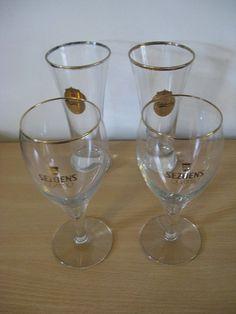 Four original glasses 2 Carlsberg and 2 Sezoens Quattro with golden rim....