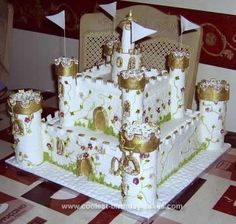 Homemade Castle Cake: This Castle cake is a 10inch square with an 8 inch square rich fruit cake stacked on top made from my own recipe. It is iced with ivory sugar paste. The