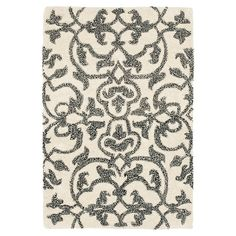 Hand-tufted+wool+rug+with+a+scrolling+vines+motif.++  Product:+RugConstruction+Material:+WoolColor:+