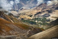 Timothy Allen   The route down to Muktinath from Thorong La Pass during the 2 week Annapurna Circuit walk.  -- Timothy Allen #travel #photography — in Nepal.