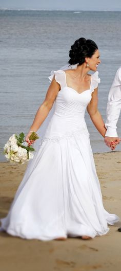 This flounce sleeve wedding gown is great for the beach or outdoor ceremony.  We make custom #weddingdresses like this for brides that are geared around the brides taste and personality.  We can also make very close #replicas of haute couture bridal gowns too. We can take a 10k dress and normally replicate if for under 2k.  So if your dream gown is out of your price range email us pictures for pricing.  Just go to our main site at www.dariuscordell.com