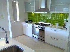 green tile splashback as an accent