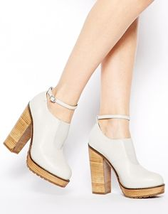 I do not know what it is with me but I love wooden heels!