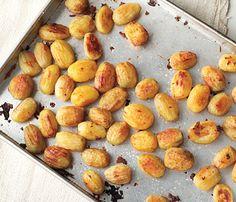 Forked Oven Roasted Potatoes. Interesting process. Par boil first, then bake....for crispness BA   December 2011       Forked Oven-Roasted Potatoes Recipe  at Epicurious.com