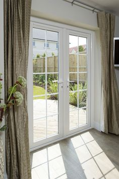 Full view of everest upvc french doors in a chartwell for Upvc french doors homebase