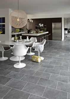 http://www.kitchenanddiningroomremodelingideas.com/kitchenflooringchoices.php has some info on the various factors to be considered when shopping for new kitchen flooring.