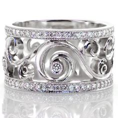 This stunning design has movement and flow with custom curl and filigree design. The spectacular pattern is decorated with diamonds and milgrain. Design 2634 from #knoxjewelers