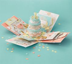 For a special occasion, sometimes you want that wow factor – a card that is just a bit out of the ordinary. Construct a show-stopping extravaganza with a hidden surprise; this neat little box opens up to reveal confetti and an adorable paper cake. Feeling ambitious? Let's give it a go!