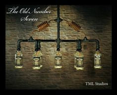 The Old Number Seven - Chandelier Light Fixture made with 7 Jack Daniel's (R) recycled Whiskey Bottles, Steampunk, Vintage, Industrial Lamp Industrial Lighting, Bar Lighting, Chandelier Lighting, Backyard Bar, Vintage Industrial, Industrial Style, Bottle Lights, Recycled Bottles, Metal Projects
