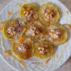 Elma dilimlerini tost makinesinde yumuşayacak şekilde pişirip,üzerine tarçın,hindistan cevizi,portakal kabuğu rendesi,ceviz,koyup,bal gezdirerek yemek tatlı krizine lezzetli bir çözüm oluyor