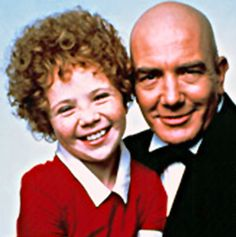 annie & daddy warbucks. I remember my parents taking me to see the musical and listening to the record over and over and over, again.