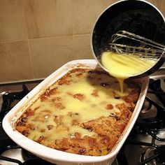 Grandma's Old-Fashioned Bread Pudding with Vanilla Sauce....omg I love love love bread pudding..minus the raisins!