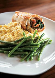 Cucina della Ragazza's Chicken Saltimbocca is served with green beans and a side of creamy polenta.
