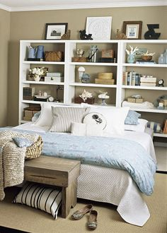 "Love pretty much everything about this bookcase headboard, from the colors to the ampersand & the bookcase styling. -- ""Showy Storage Headboard: To fashion a headboard, focal point, & display unit all in one, position a series of bookcases behind a bed... To prevent the bookcases from tipping, secure each unit to the wall with straps."""