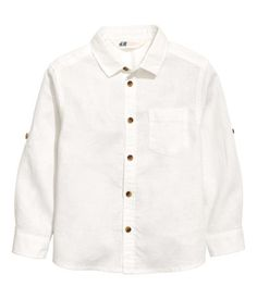 White. Shirt in a linen and cotton blend. Buttons at front, a chest pocket, and long sleeves with roll-up tab and button.