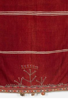 Africa | Shawl from Tunisia | Wool & cotton; The cranberry red ground with  cream stripes, embroidered at one end with three angular shrubs and geometric borders in blue, apricot, pink, cream and orange threads with tassel and pom-pom ends || Partial view ~ detail