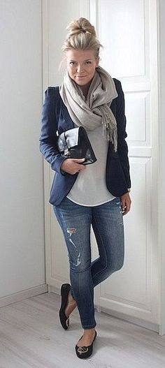 I like the boxy shoulders of the blazer, and the navy blue color. The whole outfit is great, but I'm not a fan of ripped jeans.