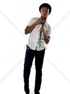 portrait of a businessman adjusting tie. - Portrait of a businessman adjusting tie against white background. Model: Nathaniel Stevenson