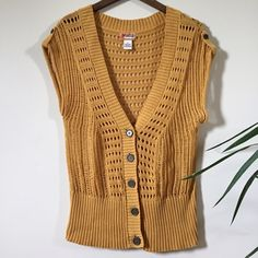 Knitted Vest Mustard color crocheted vest. This V-neck vest has brass colored buttons and shoulder epaulets. 100% cotton gives this vest a light weight, perfect for any weather. A great layering piece. I'm a size small for reference, this vest can be worn oversized or will look good for a more fitted style. HOST PICK CASUAL FRIDAY 05.20.16 Mudd Tops