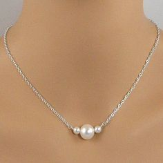 This necklace is pretty, dainty and feminine. It is made with three freshwater pearls that are suspended from sterling silver chain. There is one large pearl in the middle and two smaller pearls on ea