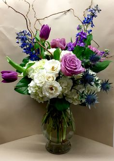 Oceanic -A large vase arrangement featuring white hydrangea, purple stock, blue delphinium, purple roses, blue thistle, purple tulips and curly willow accents - $89.95 - http://www.leighflorist.com - #leighflorist #mothersday #mothersdayflowers