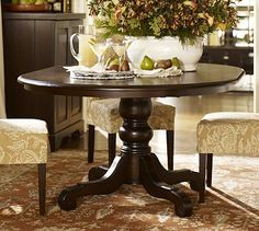 Might be too big for the kitchen, but I love round pedestal tables.