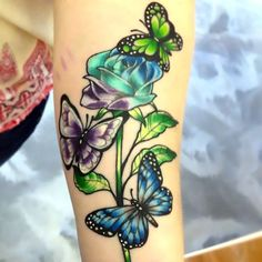 This Tattoo depicts a beautiful Rose flower with that is Green and Blue with three Butterflies hovering around it. Maybe attracted by the sweet scent of flower. Butterfly With Flowers Tattoo, Butterfly Tattoo Meaning, Butterfly Tattoo On Shoulder, Butterfly Tattoos For Women, Butterfly Tattoo Designs, Butterflies, Rose Flowers, Simple Butterfly, Vine Tattoos