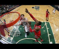 Houston Rockets at Utah Jazz - 12/2/2013 - W 109-103 Gordon Hayward of the Utah Jazz shoots around Dwight Howard of the Houston Rockets at EnergySolutions Arena in Salt Lake City, Utah.