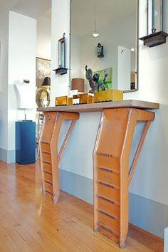 """For the """"man cave""""! Yes, you can turn old auto parts into surprisingly chic furniture. Housed in Alan Robandt's antique shop, you'd never know this entryway table was made from old car ramps at first glance. Old Car Parts, Car Part Furniture, Bedroom Furniture, Man Cave Furniture, Furniture Chairs, Garden Furniture, Outdoor Furniture, Deco Retro, Man Cave Garage"""