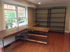 So many ideas for my office using pipe and reclaimed wood for desk configurations and floor to ceiling book shelves.